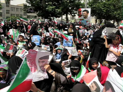 jun 2009 large group of women holding iranian flags demonstrating on street / teheran, iran / audio - human limb stock videos & royalty-free footage