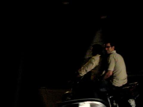 jun 2009 men making peace signs, riding on motorcycles on highway / teheran, iran / audio - human limb stock videos & royalty-free footage