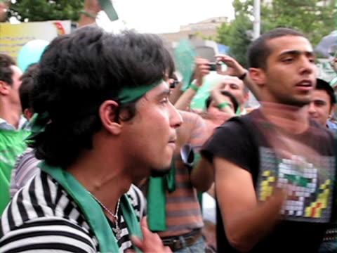 jun 2009 shaky crowd of demonstrators jumping and shouting on street / teheran, iran / audio - shaky stock videos & royalty-free footage