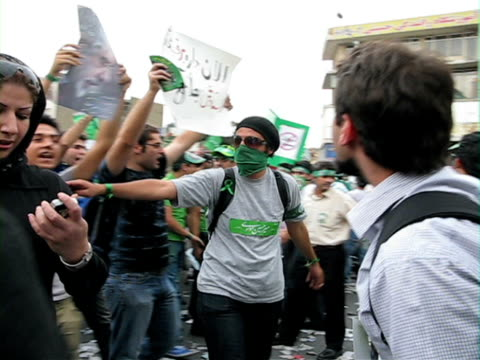 jun 2009 shaky large group of people walking in street demonstration / teheran, iran / audio - human limb stock videos & royalty-free footage