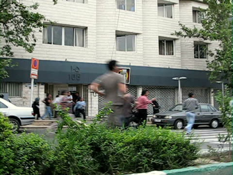 jun 2009 shaky protesters running amongst traffic on street / teheran, iran / audio - shaky stock videos & royalty-free footage