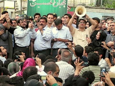 jun 2009 shaky speaker talking to crowd of people on street / teheran, iran / audio - shaky stock videos & royalty-free footage