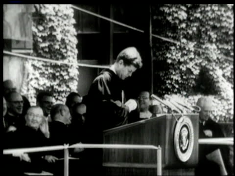 june 11 1962 montage john f kennedy speaking at yale graduation people applauding / new haven connecticut united states - 1962 stock-videos und b-roll-filmmaterial