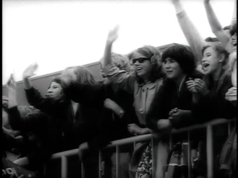 june 11 1964 montage beatles arriving in netherlands to screaming teenage fans / amsterdam the netherlands - the beatles stock videos & royalty-free footage