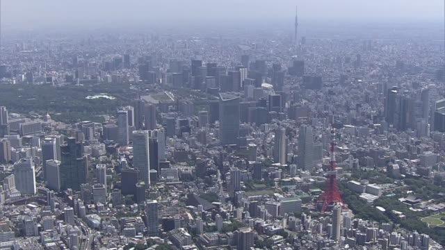 June 13 2014 aerial shot of skyline of Tokyo with Tokyo Tower Toranomon Hills and Tokyo Skytree zooming into the Toranomon Hills one of the tallest...