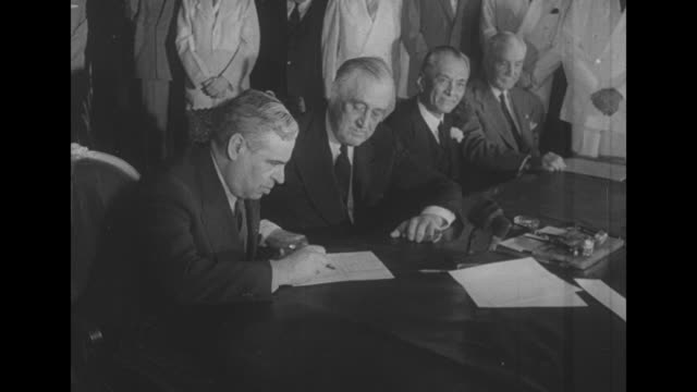 June 14 1942 US President Franklin D Roosevelt seated at table with Mexico President Manuel Avila Camacho Philippine President Manuel Quezon in front...
