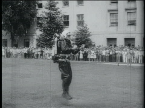 b/w june 15, 1961 tu pan man (harold graham) in jet pack takes off from ground with audience and pentagon in background / arlington, virginia - invention stock videos and b-roll footage