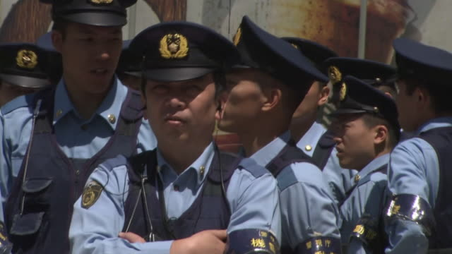 june 15 many police officers on guard around the shibuya crossing or the scramble closeup shot of a police officer on guard at the crossing a big... - soccer competition stock videos & royalty-free footage