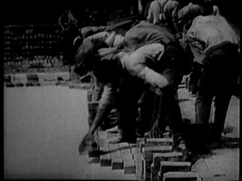 june 1926 montage ernest vicknell laying bricks for a road very quickly / galesburg, illinois, united states - 1926 stock videos & royalty-free footage