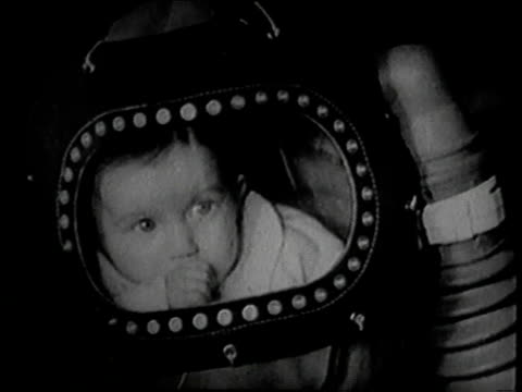 june 1939 montage babies in gas proof suits with air pumps / united kingdom - 1939 stock videos & royalty-free footage