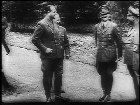 B/W June 1940 Adolf Hitler talks gestures stamps foot happily with officers / French Armistice
