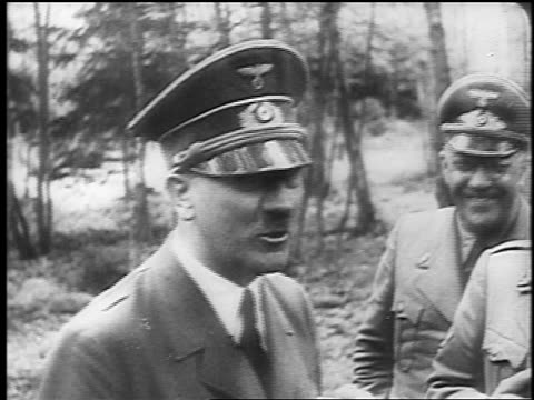 B/W June 1940 close up happy Adolf Hitler talking to officers outdoors / documentary