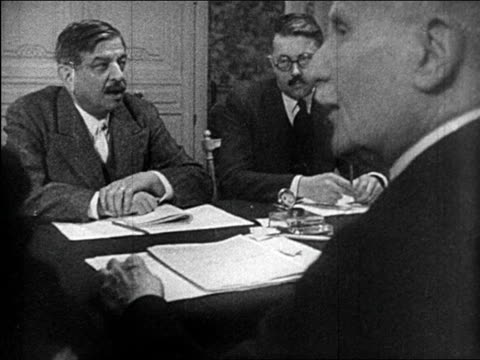 b/w june 1940 leval petain sitting with others at conference table / educational - french army stock videos & royalty-free footage