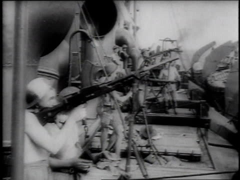 june 1942 shells exploding as soldiers fire machine guns / midway island, united states - 1942 stock videos & royalty-free footage