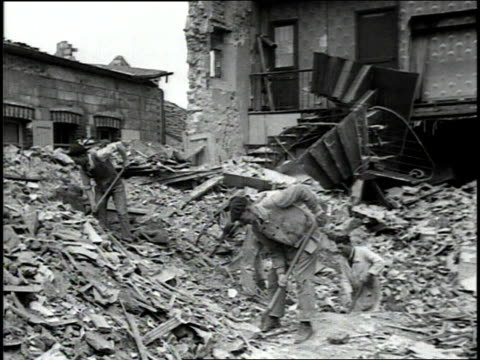 june 1944 liberated civilians digging through rubble and clearing streets with life returning to normal / normandy, france - rubble stock-videos und b-roll-filmmaterial