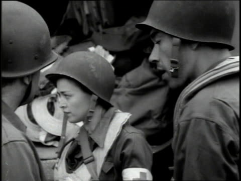 june 1944 ws medical transport pilots including some women standing around talking while their aircraft are being loaded / france - 1944 stock videos and b-roll footage