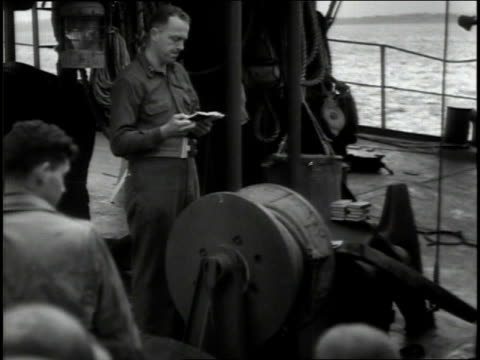 june 1944 montage senior officer briefing group of officers / aboard ship english channel - endast en pensionärsman bildbanksvideor och videomaterial från bakom kulisserna