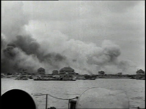 june 1944 montage smoke rising from normandy coastal fortifications after naval bombardment / english channel - 1944 stock videos & royalty-free footage