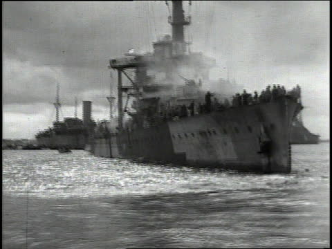 june 1944 naval flotilla in harbor with sailors leaning over railings and a mulberry artificial harbor / english channel - harbour stock videos & royalty-free footage