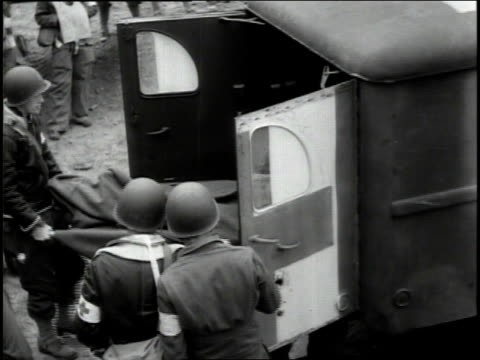 june 1944 ws wounded soldiers being transferred from an ambulance into a transport plane / france - 1944 stock videos and b-roll footage