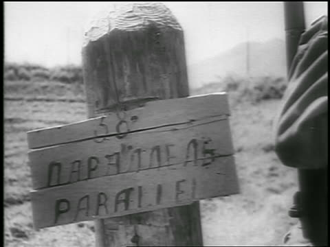 b/w june 1950 close up hand painted wooden sign written in korean english / newsreel - non western script stock videos & royalty-free footage