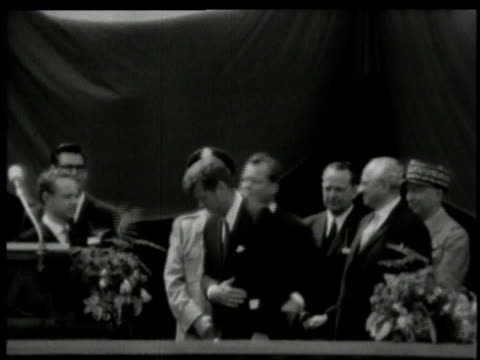 june 1963 ws john f kennedy smiling and waving to cheering berliners at city hall platz / west berlin germany - john f. kennedy politik stock-videos und b-roll-filmmaterial