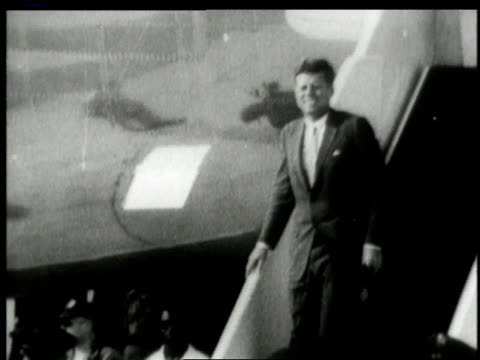 june 1963 john f. kennedy smiling and waving while getting off plane and shaking hands with man in uniform / west berlin, germany - 1963 stock videos & royalty-free footage
