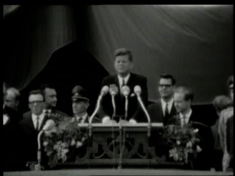 june 1963 montage john f. kennedy addressing huge turn out of berliners at cityhall platz / west berlin, germany - 西ドイツ点の映像素材/bロール