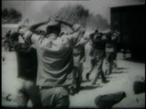 june 1967 montage egyptian soldiers surrendering and sitting in a group / middle east - sechstagekrieg stock-videos und b-roll-filmmaterial