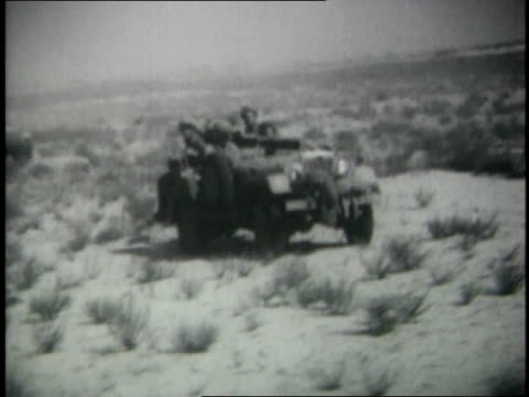 june 1967 montage israeli jeeps moving en masse across desert tank swiveling turret / egypt - sechstagekrieg stock-videos und b-roll-filmmaterial