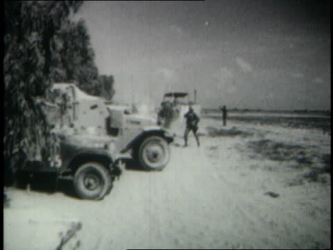 June 1967 MONTAGE Israeli jeeps tanks and war vehicles moving out toward combat zone / Egypt