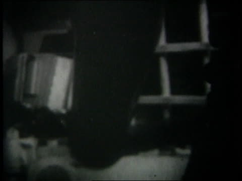 june 1967 montage tanks firing at longrange targets israeli soldier looking through binoculars / middle east - sechstagekrieg stock-videos und b-roll-filmmaterial
