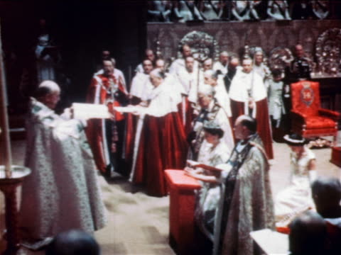 june 2, 1953 clergyman carrying book to queen elizabeth ii during coronation ceremony / documentary - 1953 stock videos & royalty-free footage