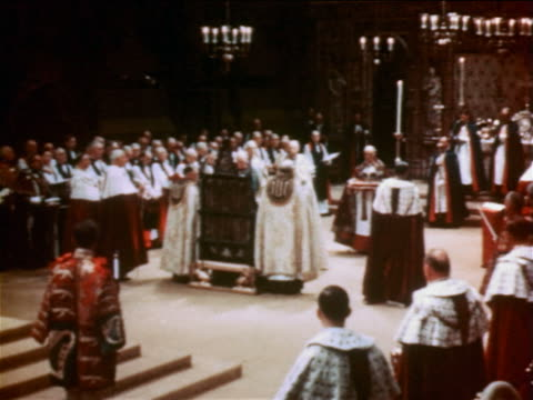 june 2, 1953 clergyman carrying crown to queen elizabeth ii during coronation ceremony / documentary - 1953 stock videos & royalty-free footage