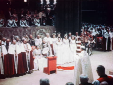 vidéos et rushes de june 2 1953 clergyman reading to queen elizabeth ii during coronation ceremony / documentary - 1953