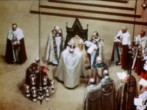 June 2 1953 high angle Archbishop putting crown on head of Queen Elizabeth II during coronation ceremony