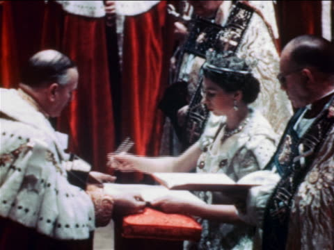 vidéos et rushes de june 2 1953 profile queen elizabeth ii signing book as clergy look on in coronation ceremony - 1953