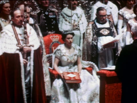 June 2 1953 Queen Elizabeth II holding Bible sitting surrounded by clergy in coronation ceremony
