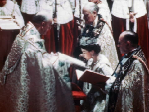 june 2, 1953 queen elizabeth ii kissing book held by clergy during coronation ceremony / documentay - 1953 stock videos & royalty-free footage