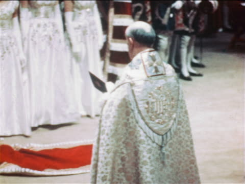june 2, 1953 rear view clergyman reading from book at queen elizabeth's coronation ceremony - 1953 stock videos & royalty-free footage