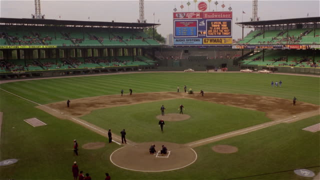 June 2, 1983 Time lapse shot of Comiskey Park from pre-game preparations and warm-up to game between Chicago White Sox and Kansas City Royals / Chicago, Illinois