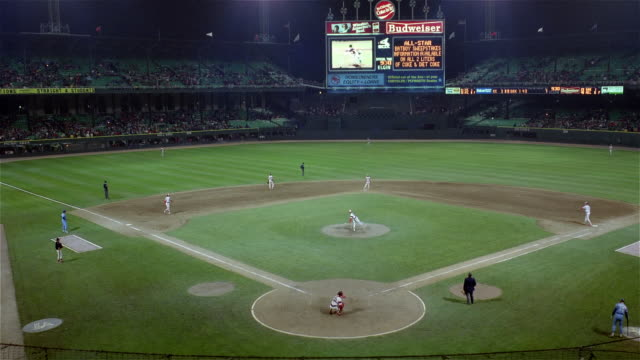 June 2, 1983 Time lapse shot of night game between Chicago White Sox and Kansas City Royals at Comiskey Park / Chicago, Illinois