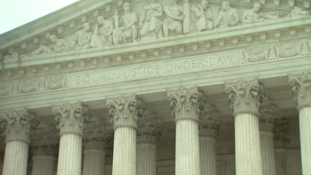 June 2 2009 ZO Pediment inscription Equal Justice Under Law at the western entrance of United States Supreme Court building / Washington DC United...