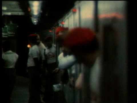 june 20 1979 film montage ms zo vigilante group 'the magnificent 13' looking out of subway train as people get off/ ms couple on subway/ ws cop... - 1979 stock videos & royalty-free footage