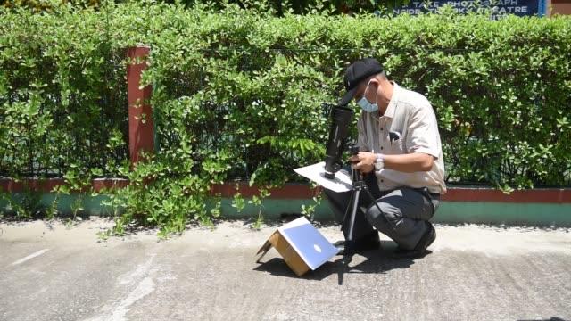 june 2010. guwahati planetarium officials prepares telescope to view solar eclipse, in guwahati, sunday, june 21, 2020. - optical equipment stock videos & royalty-free footage