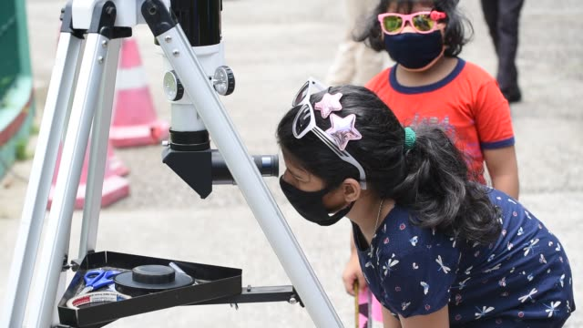 june 2010 people looks through a telescope to get a glimpse of solar eclipse at guwahati planetarium in guwahati sunday june 21 2020 - lens flare stock videos & royalty-free footage