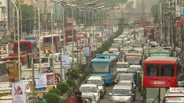 june 2016: an aerial view of vehicles stuck in gridlock kazi nazrul islam avenue road area in dhaka. bangladesh. commuters in the capital suffered a... - traffic jam点の映像素材/bロール