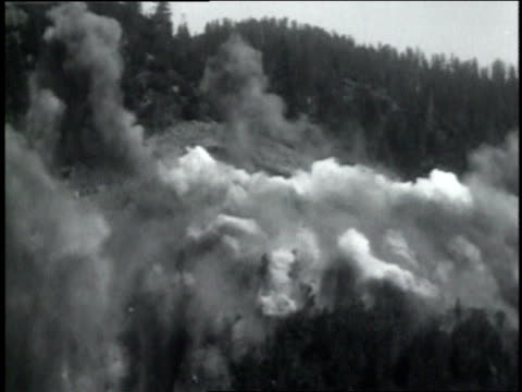 June 22, 1931 WS Huge dynamite explosion on hillside with smoke filling the air / Keddie, California, United States
