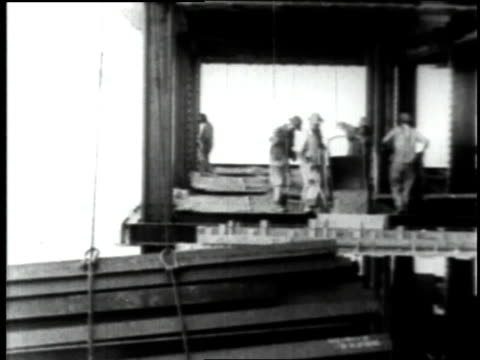 june 23 1930 ws erecting steel during empire state building construction / new york city new york united states - anno 1930 video stock e b–roll