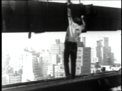 june 23 1930 ws worker placing steel beam during empire state building construction / new york city new york united states - 1930年点の映像素材/bロール